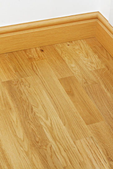 Close up showing some wood effect vinyl flooring and mdf imitation ...